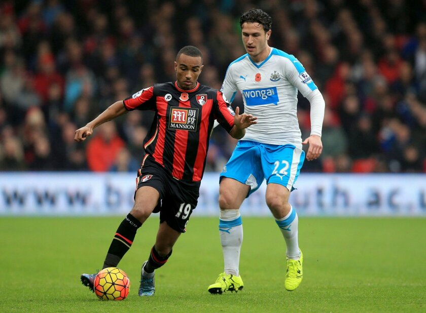 AFC Bournemouth's Junior Stanislas, left, and Newcastle United's Daryl Janmaat battle for the ball during the English Premier League soccer match at the Vitality Stadium, Bournemouth, England, Saturday Nov. 7, 2015. (John Walton/PA via AP) UNITED KINGDOM OUT