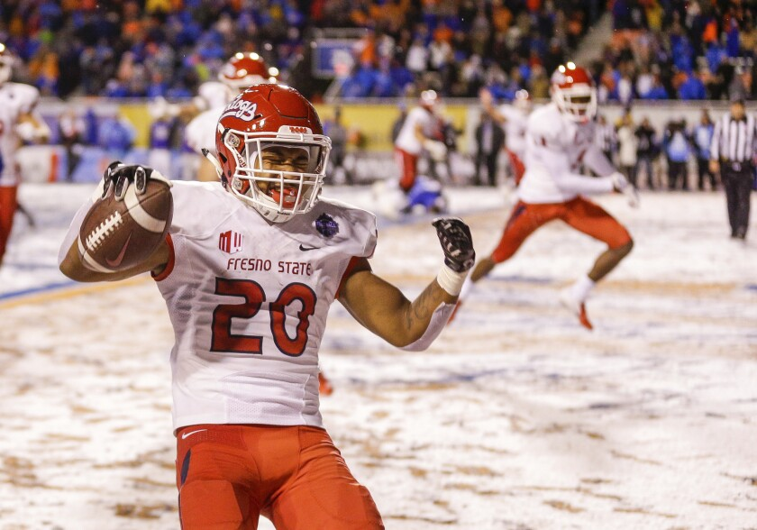 Fresno State running back Ronnie Rivers celebrates the game-winning touchdown against Boise State in overtime in the Mountain West championship game on Dec. 1, 2018 in Boise, Idaho.