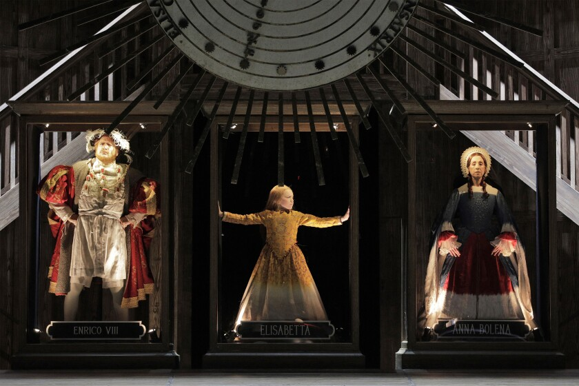 "Henry VIII (Christopher Halsted, left), Princess Elizabeth (Kira Hunziker, center) and Anne Boleyn (Donna Gale) in ""Roberto Devereux."""
