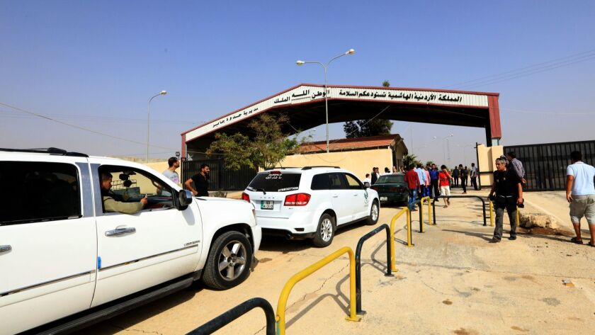 Vehicles cross from Jordan to Syria through the Jaber-Nassib border crossing after it was reopened on Oct. 15, 2018.