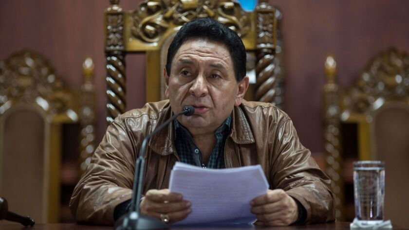 Constitutional Court head Francisco de Mata Vela leads a news conference in Guatemala City on Aug. 2