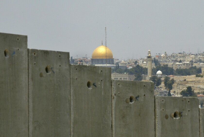 Jerusalem's Dome of the Rock, seen over a border wall from East Jerusalem.