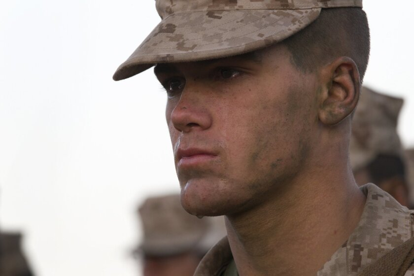 """One of the newest Marines, Pvt. Kale Milette becomes a little emotional after he awarded his """"Eagle, Globe and Anchor"""".  Marines from Charlie Company MCRD, completed the near 12-mile march to the """"reaper"""", the hill that marks the end of a grim 72-hours basic training called the crucible."""