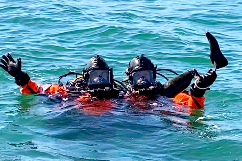 Divers from the Long Beach Fire Department with DeWalt Mix's prosthetic leg