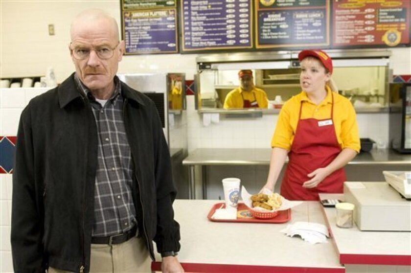 """This image released by AMC shows Bryan Cranston as Walter White at the fictional restaurant """"Los Pollos Hermanos"""" in a scene from season 2 of the AMC series """"Breaking Bad.""""  A Twisters burrito restaurant in Albuquerque that serves as the location for the restaurant has become an international touri"""