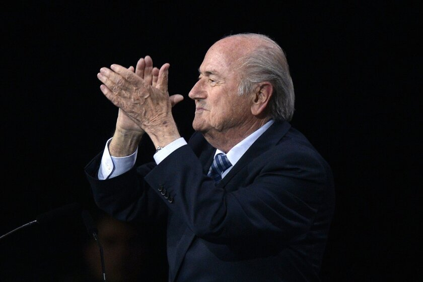 FIFA president Sepp Blatter applauds after his re-election during the 65th FIFA Congress held at the Hallenstadion in Zurich, Switzerland, Friday, May 29, 2015. Blatter has been re-elected as FIFA president for a fifth term, chosen to lead world soccer despite separate U.S. and Swiss criminal investigations into corruption. The 209 FIFA member federations gave the 79-year-old Blatter another four-year term on Friday after Prince Ali bin al-Hussein of Jordan conceded defeat after losing 133-73 in the first round. (Walter Bieri/Keystone via AP)