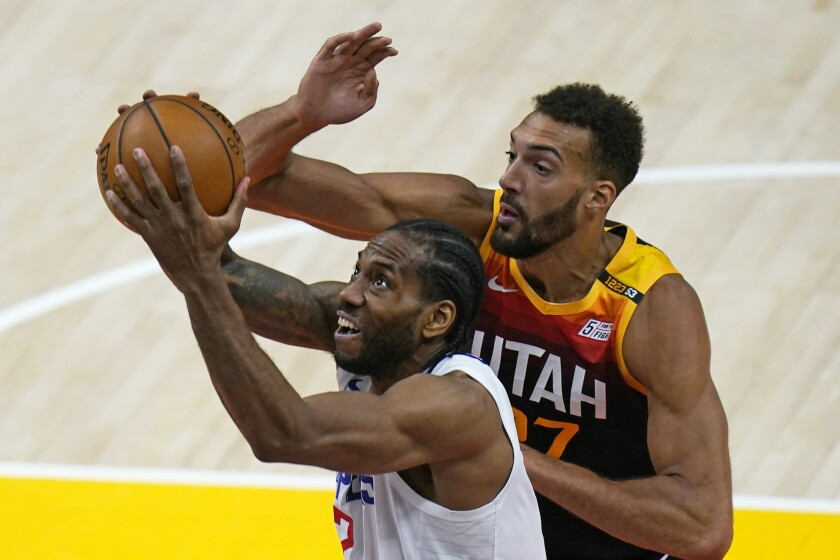 Utah Jazz center Rudy Gobert, rear, tries to block a shot by Clippers forward Kawhi Leonard during Game 1 on Tuesday.
