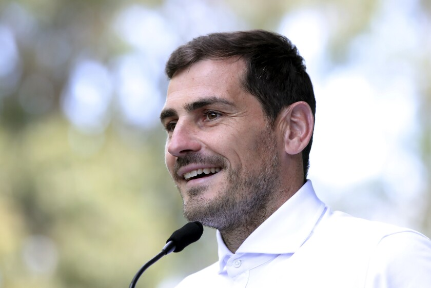 "FILE - In this Monday, May 6, 2019 file photo, Spanish goalkeeper Iker Casillas talks to journalists outside a hospital in Porto, Portugal. Former Spain and Real Madrid goalkeeper Iker Casillas said Monday June 15, 2020, he will not run for president of the Spanish soccer federation. Casillas said the main reason that led him to change his mind was ""the exceptional social, economic and health situation that our country is suffering."" (AP Photo/Luis Vieira, File)"