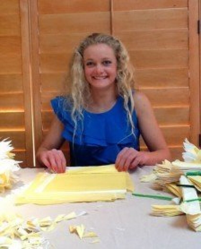 CCHS junior Mikaela Greeven makes paper flowers for cancer patients. Courtesy photo