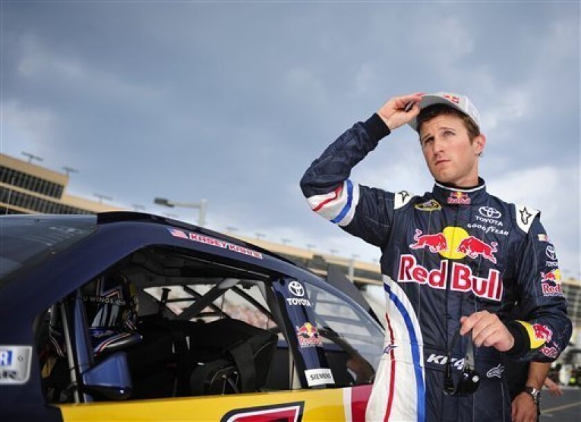 NASCAR driver Kasey Kahne leaves his car after taking the pole position during Sprint Cup qualifying for the AdvoCare 500 auto race on Saturday, Sept. 3, 2011, at the Atlanta Motor Speedway, in Hampton, Ga. (AP Photo/Rainier Ehrhardt)
