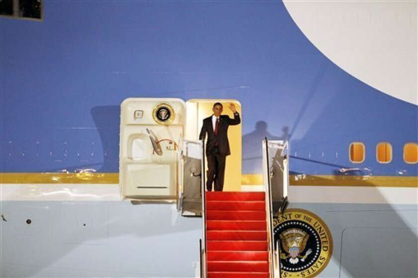 President Barack Obama waves from Air Force One upon arrival at Andrews Air Force Base, Md., on Wednesday, Oct. 6, 2010. (AP Photo/Jose Luis Magana)