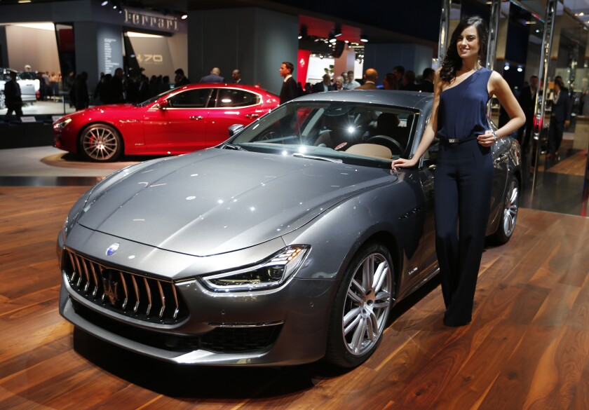 FILE - This Sept. 24, 2017 file photo shows a Maserati Ghibli Granlusso on display during the first media day of the International Frankfurt Motor Show IAA in Frankfurt, Germany. Luxury carmaker Maserati said Thursday, Sept. 26, 2019, that its highly successful four-door Ghibli sedan will be the first of its models produced with a hybrid powertrain. The carmaker owned by Fiat Chrysler Automobiles announced production and electrification roll-outs as part of plans announced last year to invest 5 billion euros in Italian production from 2019-2022. (AP Photo/Michael Probst)