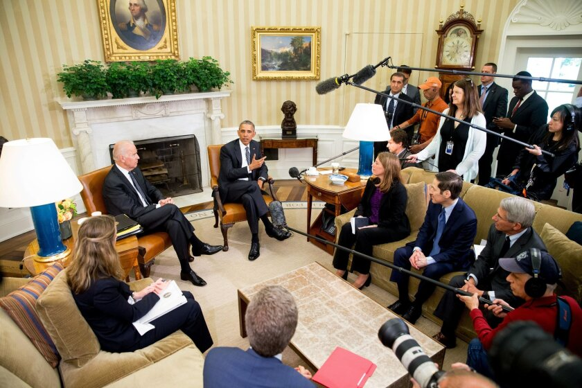 President Barack Obama, accompanied by Vice President Joe Biden, left, speaks to members of the media after receiving a briefing on the ongoing response to the Zika virus from members of his public health team, Friday, May 20, 2016, in the Oval Office at the White House in Washington. The Senate appears ready to pass a $1.1 billion bipartisan bill that falls short of the $1.9 billion in emergency funding to combat the Zika virus requested by the Obama Administration. (AP Photo/Andrew Harnik)