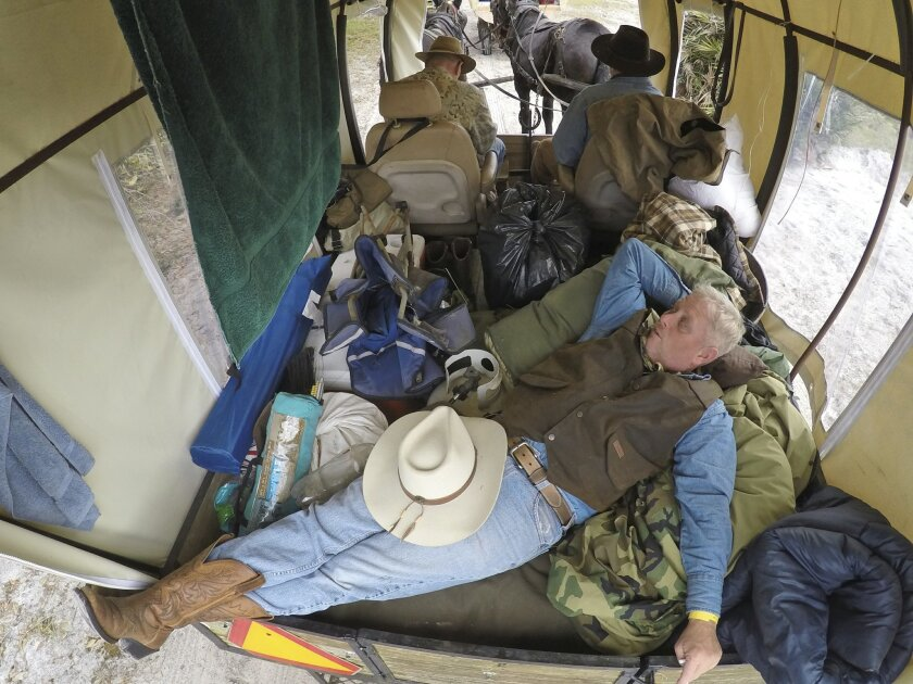 In this Tuesday, Jan. 26, 2016 photo, veteran Steve Pyle of DeLand, Fla., attended the Great Florida Cattle Drive 2016, in Kenansville, Fla., with the Wounded Warrior Project. (AP Photo/Wilfredo Lee)