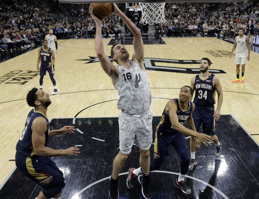 FILE - In this Saturday, Feb. 2, 2019 file photo, San Antonio Spurs center Pau Gasol (16) shoots past New Orleans Pelicans center Jahlil Okafor (8), forward Wesley Johnson (33) and guard Kenrich Williams (34) during the second half of an NBA basketball game in San Antonio. Pau Gasol wants to return to the NBA but does not rule out going back to Europe for his retirement. (AP Photo/Eric Gay, File)