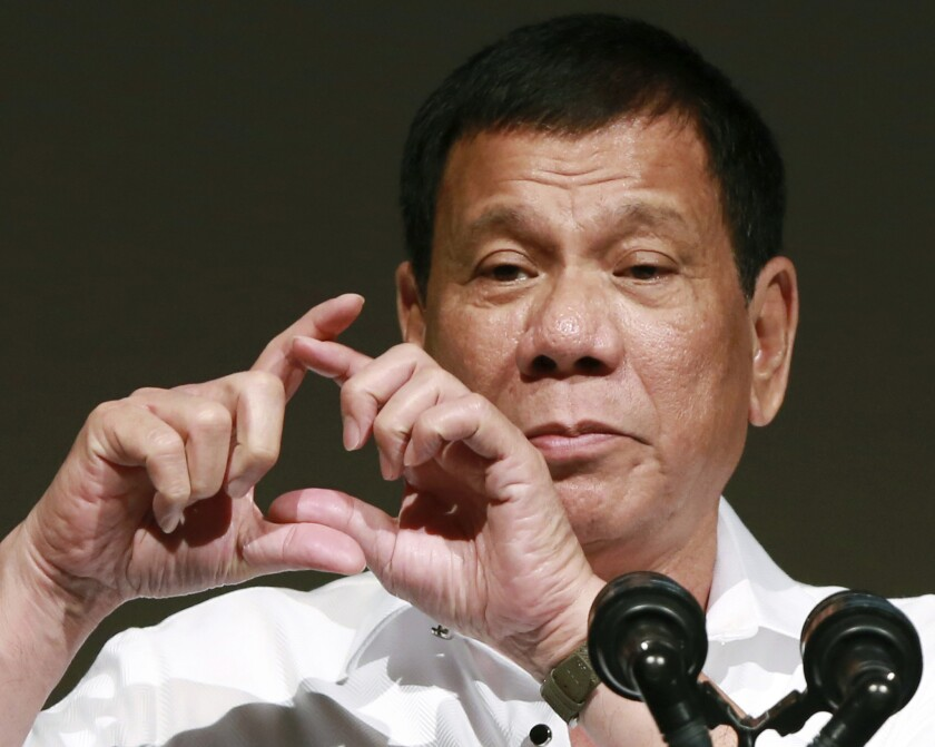 Philippine President Rodrigo Duterte makes a sign with his hands