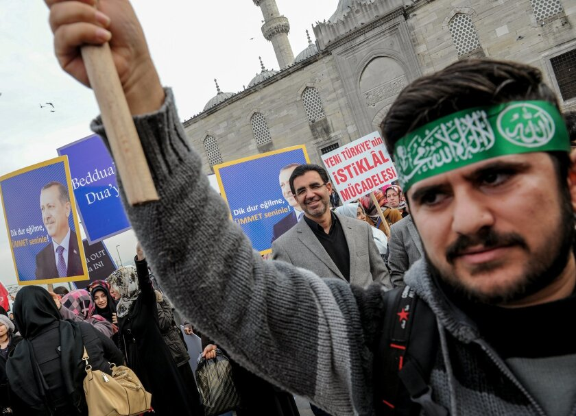 Supporters of Prime Minister Recep Tayyip Erdogan demonstrate outside a mosque in Istanbul, Turkey, Friday, Dec. 27, 2013. Erdogan on Friday faced mounting accusations of trying to cover up a corruption scandal that has implicated his allies after a prosecutor said he was being prevented from expan