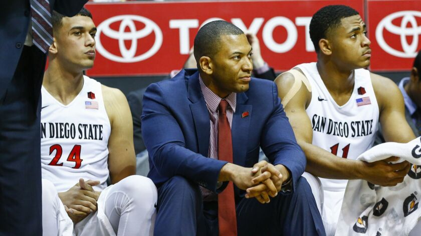 Tim Shelton (center)is leaving SDSU after 11 years with the program as as player or coach.