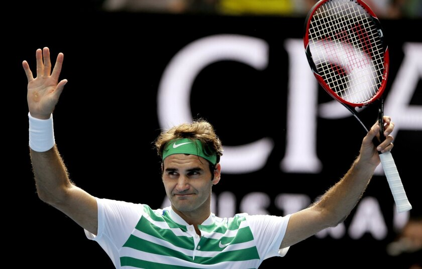 Roger Federer of Switzerland celebrates after defeating Tomas Berdych of the Czech Republic in their quarterfinal match at the Australian Open tennis championships in Melbourne, Australia, Tuesday, Jan. 26, 2016.(AP Photo/Aaron Favila)