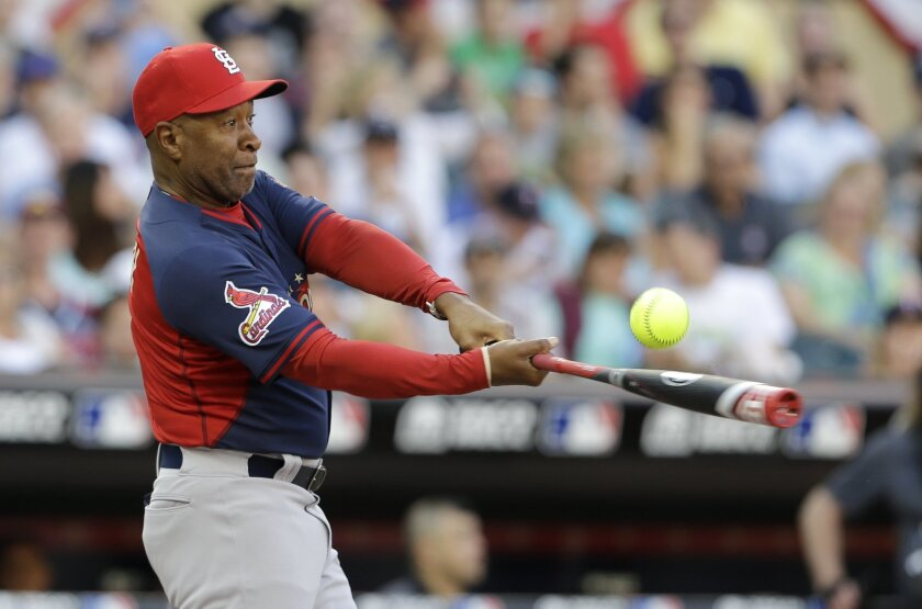 Formers St. Louis Cardinals shortstop Ozzie Smith bats during the All-Star Legends & Celebrity Softball Game, Sunday, July 13, 2014, in Minneapolis. (AP Photo/Paul Sancya)