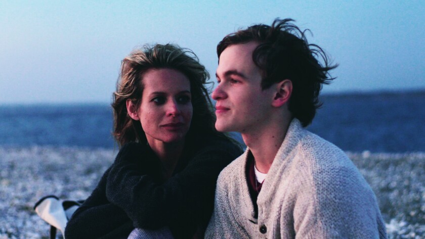 """Jessalyn Gilsig as Anna Thompson, left, and Graham Patrick Martin as Travis Tratten in """"Somewhere Slow."""""""