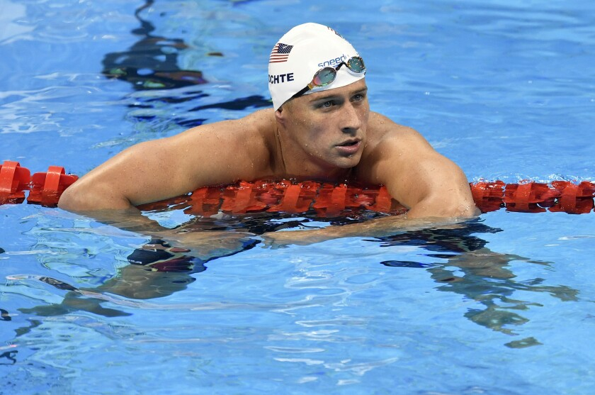 Ryan Lochte checks his time after a freestyle relay heat during the Rio Olympics.