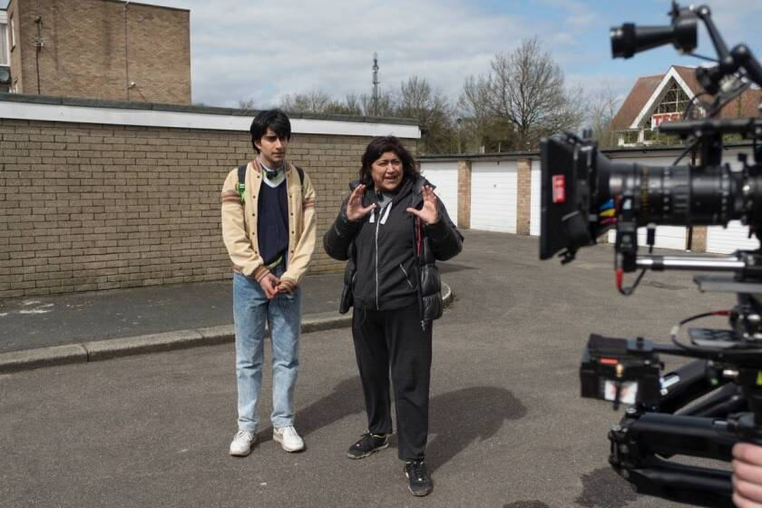 "Viveik Kalra, left, and director Gurinder Chadha on the set of ""Blinded By the Light."""