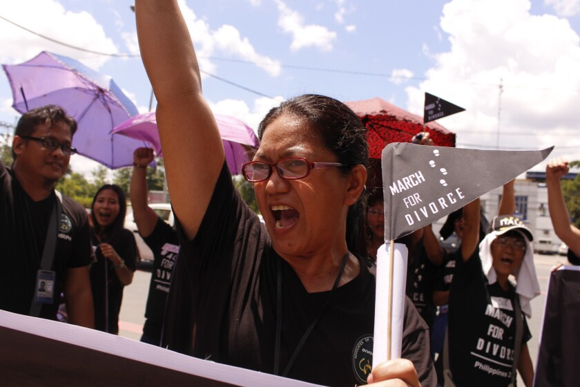 Lu Mercado raises her fists at a rally in Manila on Aug. 3, 2016, demanding legalization of divorce in the Philippines.