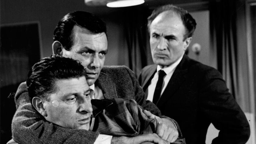 1967 file photo of William Raisch, the one–armed man; David Janssen and Barry Morse in an episode fr