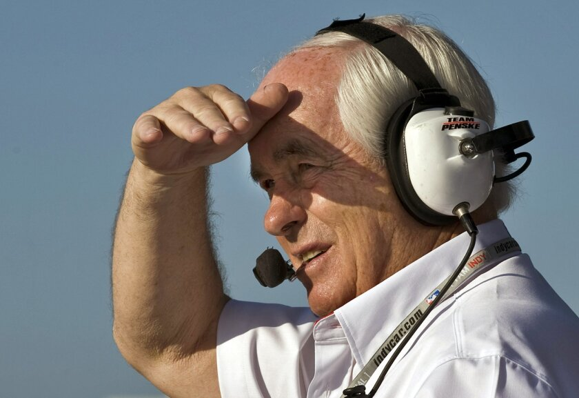 FILE - In this April 4, 2009, file photo, team owner Roger Penske shades his eyes as he watches the start of morning practice for the IRL Indy Car Honda Grand Prix of St. Petersburg auto race, in St. Petersburg, Fla. With all the hoopla surrounding the 100th Indianapolis 500, Roger Penske has a celebration of his own going — the 50th anniversary of Team Penske. (AP Photo/Steve Nesius, File)