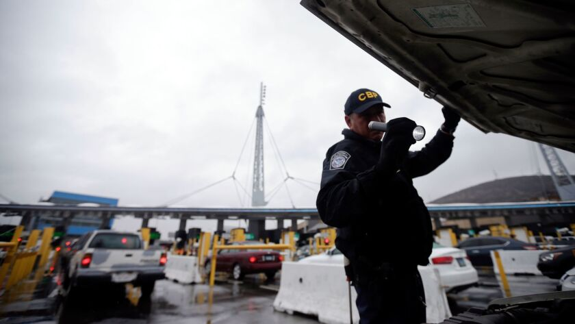 FILE - In this Dec. 3, 2014 file photo, a U.S. Customs and Border Protection (CBP) officer checks un