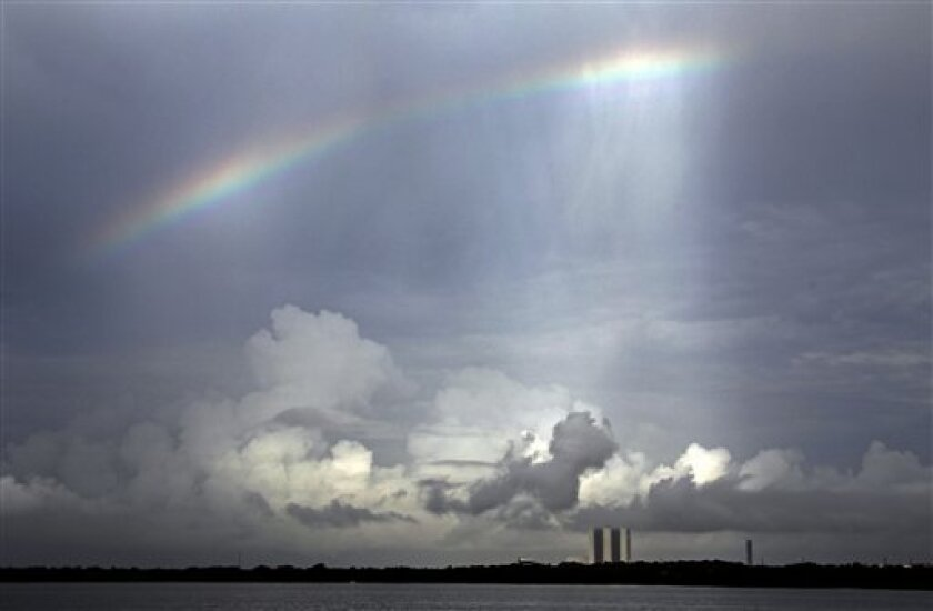 A rainbow is seen over the Vehicle Assembly Building at the Kennedy Space Center Thursday, July 7, 2011, in Cape Canaveral, Fla. The space shuttle Atlantis is scheduled to launch on Friday, July 8 and is the 135th and final space shuttle launch for NASA. (AP Photo/Terry Renna)
