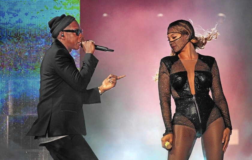 Tidal executives are scrambling to repair the service's image as they try to transform Jay Z's $56-million purchase into a formidable entrant into the streaming music business. Above, Jay Z and Beyonce perform at the Rose Bowl last year.