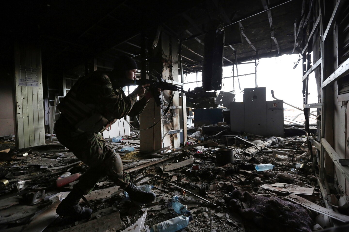 A Ukrainian soldier patrols inside the Donetsk airport. It has been the scene of fierce fighting between government troops and pro-Russia separatists since May.