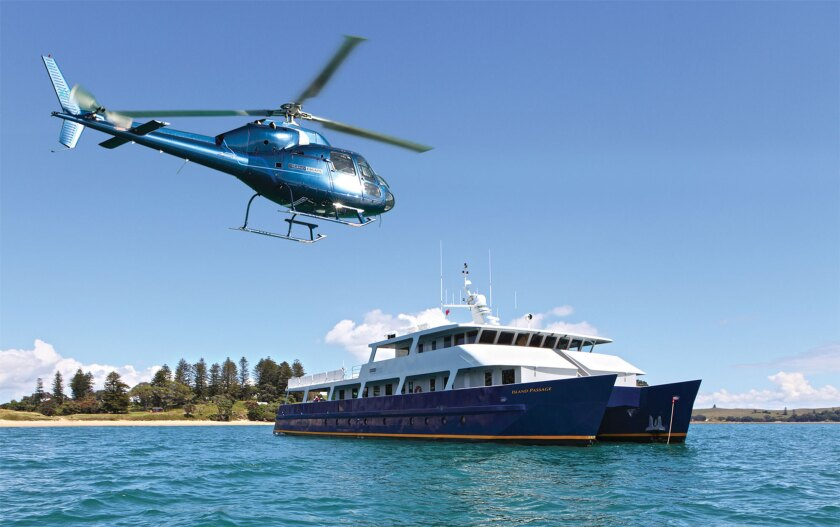 Island Passage, built to cruise New Zealand waters, has a helicopter to take guests to locales that can be reached only by air.