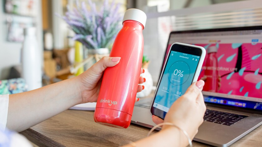 DrinKup bottle with a smart phone. Credit: Michael Wesley Titgemeyer