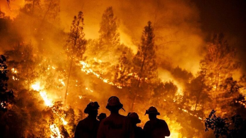 Firefighters monitor a burn operation near Lodoga, Calif., on Aug. 7, 2018, during the Mendocino Complex fire.