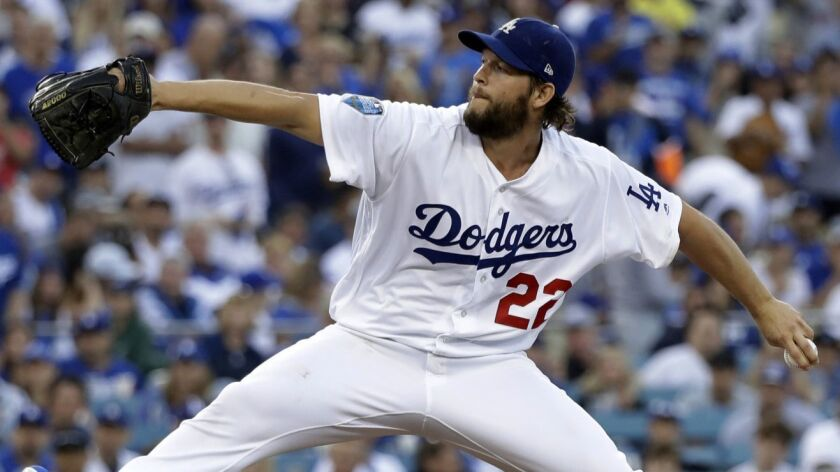 FILE - In this Oct. 28, 2018, file photo, Los Angeles Dodgers pitcher Clayton Kershaw winds up durin