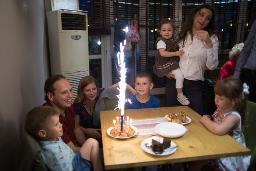 Tsvetelina and Svilen Hristov celebrate the birthday of their son Toma at a restaurant in Sofia.