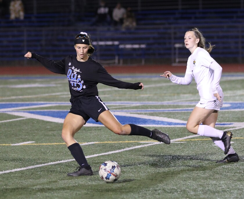 Ramona High senior girls soccer player Ally Slade about to tie the May 10 home game against against Valley Center High.