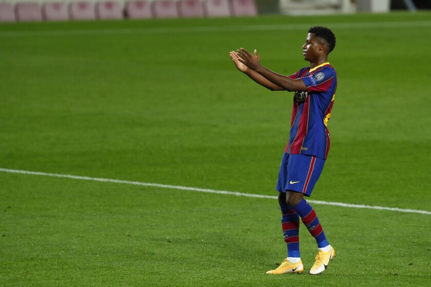 Barcelona's Ansu Fati celebrates after scoring his side's second goal during the Champions League group G soccer match between FC Barcelona and Ferencvaros at the Camp Nou stadium in Barcelona, Spain, Tuesday, Oct. 20, 2020. (AP Photo/Joan Monfort)