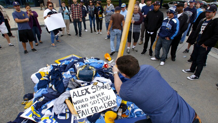 Stephen Black smashes a pile of Chargers memorabilia outside the team's complex in San Diego on Thursday.