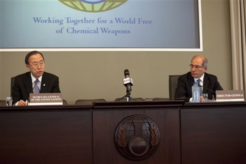 U.N. Secretary-General Ban Ki-moon, left, speaks at the headquarters of the Organization for the Prohibition of Chemical Weapons (OPCW) in The Hague, Netherlands, Monday, April 8, 2013. Ban Ki-moon says inspectors are ready to deploy to Syria within 24 hours to investigate reported chemical weapon attacks in the country's two-year civil war but have no permission yet from President Bashar Assad's government. At right Director General of OPCW Ahmet Uzumcu is seen. (AP Photo/Jan-Joseph Stok)