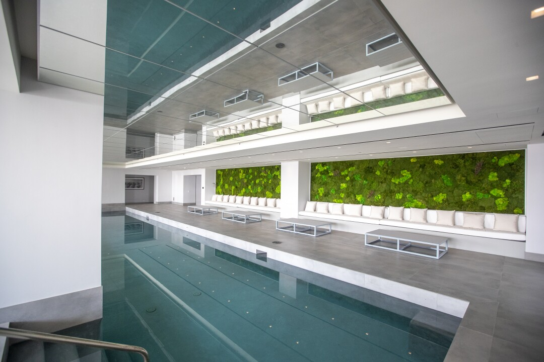 A view of the indoor pool and living wall at The One.