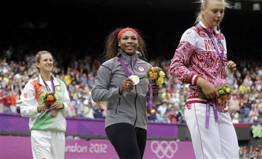 From left, bronze medalist Victoria Azarenka of Belarus, gold medalist Serena Williams of the United States and silver medalist Maria Sharapova of Russia walk out of the court after the medal ceremony of the women's singles final match at the All England Lawn Tennis Club at Wimbledon, in London, at the 2012 Summer Olympics, Saturday, Aug. 4, 2012. (AP Photo/Victor R. Caivano)