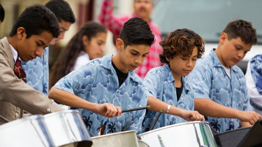 "Southwest Middle students play ""Don't Stop Believin"" on steel drums during their performance."