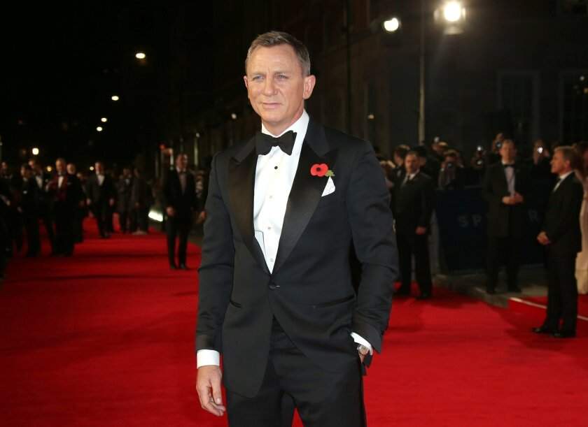 """FILE - In this Monday, Oct. 26, 2015 file photo, Daniel Craig poses for photographers upon arrival for the World Premiere of """"Spectre"""" at the Royal Albert Hall in central London. Craig stars as James Bond in the new Bond movie which releases in U.S. theaters on Nov. 6, 2015. (Photo by Joel Ryan/Inv"""
