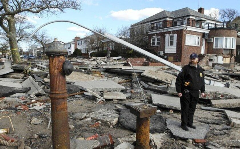 Pinny Dembitzer surveys damage in the Sea Gate neighborhood of Coney Island. Scientists and political observers believe the devastation from Hurricane Sandy, along with New York Mayor Michael R. Bloomberg's focus on climate change in his endorsement of President Obama, may bring attention to the issue of global warming.