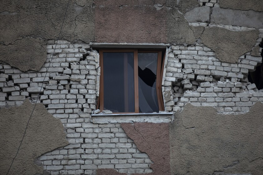 In this Wednesday, Nov. 27, 2019 photo, the broken window of a damaged building in Thumane, western Albania following a deadly earthquake. The 6.4-magnitude quake that hit Albania's Adriatic coast before dawn on Tuesday has left at least 51 people dead, around 2,000 others injured and about 4,000 people homeless. (AP Photo/Petros Giannakouris)