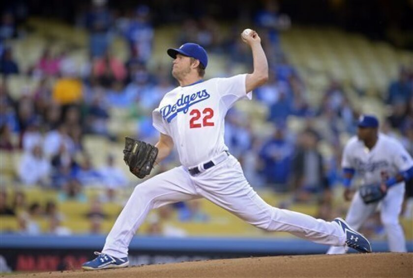 Los Angeles Dodgers starting pitcher Clayton Kershaw throws to the plate during the first inning of their baseball game against the Arizona Diamondbacks, Wednesday, May 8, 2013, in Los Angeles. (AP Photo/Mark J. Terrill)